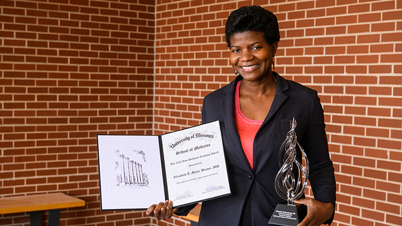 Elizabeth Malm-Buatsi, MD with her 2020 Education Day Awards for the University of Missouri School of Medicine.