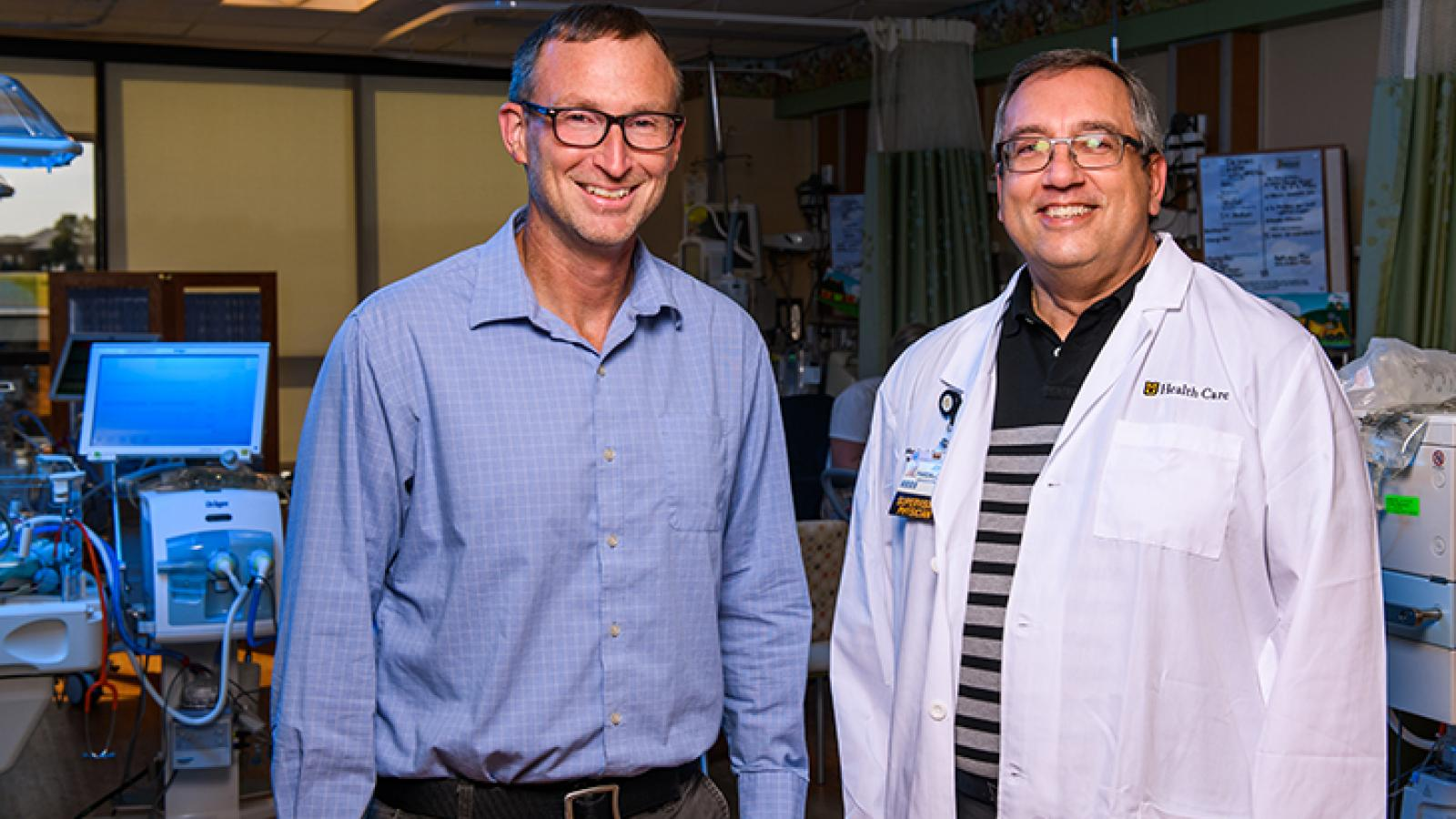 Photo of Dr. Fales and Dr. Pardalos