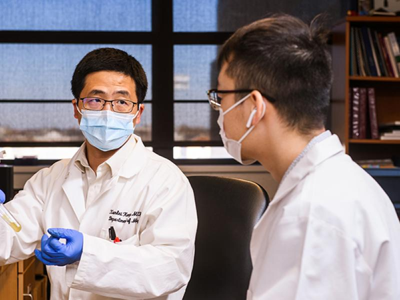 Xunlei Kang, MD, PhD in his lab